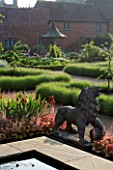 THE WALLED GARDEN AT COWDRAY  WEST SUSSEX. DESIGNER: JAN HOWARD - LION STATUE & RAISED POND/POOL WITH HEUCHERA MARMALADE  DARK RED IRIS SULTANS PALACE & LAVENDER HIDCOTE