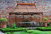 THE WALLED GARDEN AT COWDRAY  WEST SUSSEX. DESIGNER: JAN HOWARD - METAL GAZEBO AND PARTERRE OF LOW LEVEL BOX EDGED BEDS