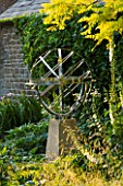 DAVID HARBER SUNDIALS: STAINLESS STEEL ARMILLARY SPHERE SUNDIAL ON A STONE PLINTH AT PETTIFERS  OXFORDSHIRE