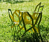 LA NORIA  FRANCE. GARDEN DESIGNED BY ARNAUD MAURIERES AND ERIC OSSART - SCULPTURES IN THE PRAIRIE DE SCULPTURES YELLOW METAL CHAIR