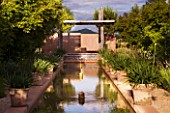 LA NORIA  FRANCE. GARDEN DESIGNED BY ARNAUD MAURIERES AND ERIC OSSART - WATER GARDEN - ISLAMIC STYLE GARDEN WITH RILL AND COVERED SEATING AREA (KIOSQUE)