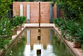LA NORIA  FRANCE. GARDEN DESIGNED BY ARNAUD MAURIERES AND ERIC OSSART - WATER GARDEN - ISLAMIC STYLE GARDEN WITH RILL AND CONCRETE WALL AND SEATS