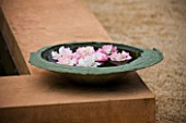 LA NORIA  FRANCE. GARDEN DESIGNED BY ARNAUD MAURIERES AND ERIC OSSART - STONE BOWL WITH FLOATING FLOWERS