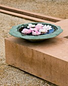 LA NORIA  FRANCE. GARDEN DESIGNED BY ARNAUD MAURIERES AND ERIC OSSART - STONE BOWL WITH FLOATING FEATHERS