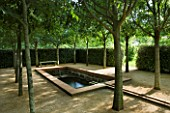 LA NORIA  FRANCE. GARDEN DESIGNED BY ARNAUD MAURIERES AND ERIC OSSART - THE CLOITRE DES MICOCOULIERS - ISLAMIC STYLE WATER GARDEN - WATER BASIN  RILL AND TREES