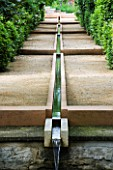 LA NORIA  FRANCE. GARDEN DESIGNED BY ARNAUD MAURIERES AND ERIC OSSART - THE ALLEE DES CYPRES - THE ISLAMIC STYLE WATER GARDEN - RILL