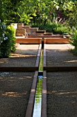 LA NORIA  FRANCE. GARDEN DESIGNED BY ARNAUD MAURIERES AND ERIC OSSART - THE ALLEE DES CYPRES - THE ISLAMIC STYLE WATER GARDEN - RILL LEADING TO WATER BASIN AND STONE FOUNTAIN