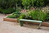 LA NORIA  FRANCE. GARDEN DESIGNED BY ARNAUD MAURIERES AND ERIC OSSART - GREEN CONCRETE BENCH AND BORDER OF GAURA