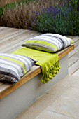 DESIGNER: CHARLOTTE ROWE  LONDON: RAISED DECK WITH CUSHIONS AND THROWS