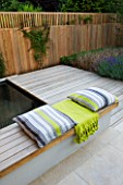 DESIGNER: CHARLOTTE ROWE  LONDON: FORMAL TOWN/CITY GARDEN WITH SPLIT-LEVEL DECK  FENCE/TRELLIS  POOL AND CUSHIONS/ THROW