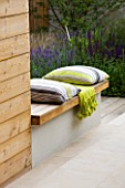 DESIGNER: CHARLOTTE ROWE  LONDON: FORMAL TOWN/CITY GARDEN WITH SPLIT LEVEL DECK WITH CUSHIONS AND THROW