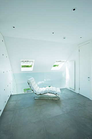 TANIA_LAURIE__LONDON_CONTEMPORARY_WHITE_CHAIR_IN_WHITE_THEMED_BEDROOM