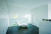 TANIA LAURIE  LONDON. CONTEMPORARY WHITE CHAIR IN WHITE THEMED BEDROOM