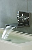 TANIA LAURIE  LONDON. STYLISH  CONTEMPORARY CHROME WALL MOUNTED TAP