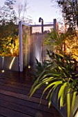 CONTEMPORARY FORMAL ROOF TERRACE/ GARDEN DESIGNED BY DATA NATURE ASSOCIATES: MODERN METAL SHOWER LIT AT NIGHT WITH METAL BEAD SCREEN AND DECKING
