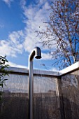 CONTEMPORARY FORMAL ROOF TERRACE/ GARDEN DESIGNED BY DATA NATURE ASSOCIATES: MODERN METAL SHOWER LIT AT NIGHT WITH METAL BEAD SCREEN