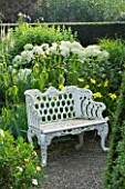 WOLLERTON OLD HALL  SHROPSHIRE:WHITE METAL SEAT IN WELL GARDEN WITH HYDRANGEA ARBORESCENS ANNABELLE. BEHIND IS PHLOMIS RUSSELIANA AND TO THE RIGHT IS HEMEROCALLIS GREEN FLUTTER