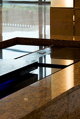 DAVID_HARBER_SUNDIALS_WATER__FEATURE_AT_SOFITEL_HOTEL__HEATHROW_TERMINAL_5