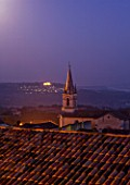 PROVENCE  FRANCE: BONNIEUX CHURCH IN M OONLIGHT WITH LACOSTE BEYOND