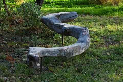 PROVENCE__FRANCE_DOMAINE_DE_LA_VERRIERE_A_PLACE_TO_SIT_WOODEN_SNAKE_SCULPTURE_AMONGST_TREES_BY_MARC_