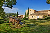PROVENCE  FRANCE: DOMAINE DE LA VERRIERE: VIEW OF THE PROPERTY WITH A CARRIAGE IN THE FOREGROUND