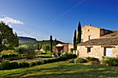 PROVENCE  FRANCE: DOMAINE DE LA VERRIERE: VIEW OF THE PROPERTY WITH THE WHITE GARDEN IN THE FOREGROUND