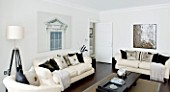 CHRISTMAS - LIVING ROOM WITH CREAM SOFAS  CUSHIONS AND TRIPOD LAMP. SARAH EASTEL LOCATIONS/ DI ABLEWHITE