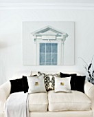 CHRISTMAS - LIVING ROOM WITH CREAM SOFAS  CUSHIONS AND WALL PRINT. SARAH EASTEL LOCATIONS/ DI ABLEWHITE