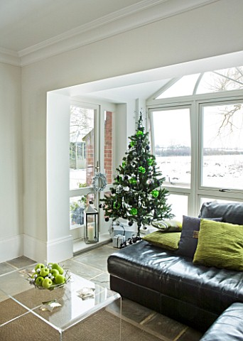 CHRISTMAS__LOUNGE_IN_LIME_GREEN_AND_BLACK__BLACK_LEATHER_SOFAS__LIME_GREEN_CUSHIONS__CHRISTMAS_TREE_