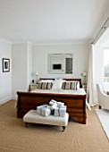 CHRISTMAS - MASTER BEDROOM MWITH LARGE WOODEN DOUBLE BED AND WRAPPED PRESENTS.  SARAH EASTEL LOCATIONS/ DI ABLEWHITE