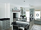 CHRISTMAS - BLACK AND WHITE KITCHEN. SARAH EASTEL LOCATIONS/ DI ABLEWHITE