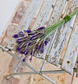 PRIVATE VILLA  CORFU  GREECE. DESIGN BY ALITHEA JOHNS - HAND-TIED LAVENDER ARRANGEMENT ON OLD CHAIR