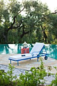 VILLA ONEIRO  CORFU  DESIGNER GINA PRICE: VIEW ACROSS THE SWIMMING POOL WITH SUN LOUGERS FROM MOROCCO