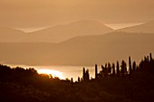 THE ROU ESTATE  CORFU: DAWN LIGHT ON CORFU HILLS AND ALBANIAN MOUNTAINS BEYOND
