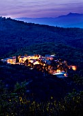 THE ROU ESTATE  CORFU: THE ROU ESTATE AT NIGHT WITH LIGHTING - ALBANIAN MOUNTAINS BEYOND
