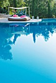 THE ROU ESTATE  CORFU: THE SWIMMING POOL WITH A WICKER SEAT WITH AWNING AND PINK CUSHIONS