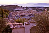 THE ROU ESTATE  CORFU: VIEW ACROSS TILED ROOFS AT DAWN WITH ALBANIAN MOUNTAINS BEYOND