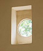 THE ROU ESTATE  CORFU: RECTANGULAR ALCOVE WITH CIRCULAR WINDOW DETAIL