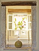 THE ROU ESTATE  CORFU: VIEW THROUGH ALCOVE TO WINDOW WITH FLORAL BLIND AND WOODEN BEAMS