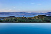 THE KAPARELLI ESTATE  CORFU - VIEW OVER INFINITY SWIMMING POOL OUT TO SEA WITH ALBANIAN MOUNTAINS BEYOND