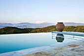 THE KAPARELLI ESTATE  CORFU - VIEW OVER INFINITY SWIMMING POOL TO ALBANIAN MOUNTAINS BEYOND