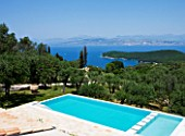 THE KAPARELLI ESTATE  CORFU - VIEW OVER SWIMMING POOL OUT TO SEA WITH ALBANIAN MOUNTAINS BEYOND