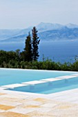 THE KAPARELLI ESTATE  CORFU - VIEW OVER SWIMMING POOL TO SEA WITH ALBANIAN MOUNTAINS BEYOND