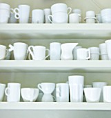 JOA STUDHOLMES LONDON HOME: WHITE CROCKERY IN WHITE CABINET