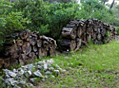 JACQUELINE MORABITO  FRANCE - HUGE LOGS PILED TOGETHER AS A WALL SCULPTURE