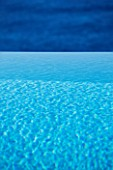 CORFU  GREECE: DESIGNER: DOMINIC SKINNER - INFINITY SWIMMING POOL - VIEW ACROSS POOL OUT TO SEA