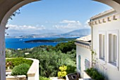 PRIVATE VILLA  CORFU  GREECE. DESIGN BY ALITHEA JOHNS - VIEW THROUGH ARCHWAY TO ALBANIA