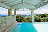 PRIVATE VILLA  CORFU  GREECE. DESIGN BY ALITHEA JOHNS - COVERED SWIMMING POOL WITH VIEW OUT TO ALBANIA