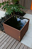 DESIGNERS WYNNIAT- HUSEY CLARKE: MODERN  CONTEMPORARY TOWN GARDEN IN BRIGHTON - SQUARE METAL WATER FEATURE WITH SHADOW/ REFLECTION OF ARALIA  DECKING