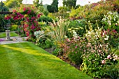 MEADOW FARM  WORCESTERSHIRE: SUNDIAL ARBOUR AND HERBACEOUS BORDER IN SUMMER